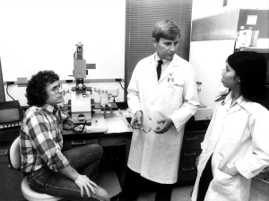 In lab with trainees, including Dr. Timothy Stout, an M.D./Ph.D. student at the time and current chair of ophthalmology at Baylor