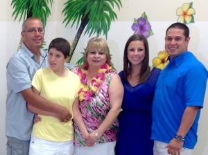 The Guerrero family. Viola and Gene Guerrero stand on either side of  Gina in yellow. Son Michael  and daughter-in-law Kerryann are to the right.