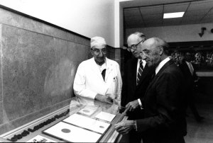 Dr.Michael DeBakey, Dr. William Butler and Dr. Roger Guillemin (left to right) view the Nobel Prize medal and certificates Guillemin received in 1977.
