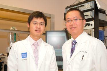 Dr. Yong Xu (R) and Dr. Yanlin He, research associate in Dr. Xu's lab.